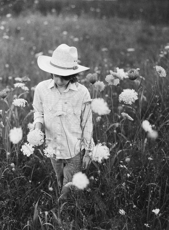 Cowboy in Dallas in wild flower field.