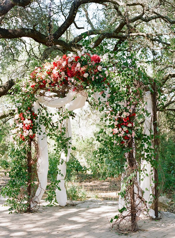 Floral rose wedding arch by Floral Affairs Unlimited.